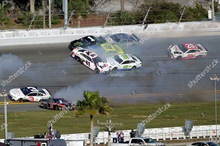 Kurt Busch (1), Denny Hamlin (11), Aric Almirola (10), Ryan Blaney (12) and Kevin Harvick (4) are involved in a multi-car collision between Turns 3 and 4 during the NASCAR Daytona Clash auto race at Daytona International Speedway, in Daytona Beach, Fla