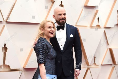 Stock Image of Arianne Sutner, Chris Butler. Arianne Sutner, left, and Chris Butler arrive at the Oscars, at the Dolby Theatre in Los Angeles