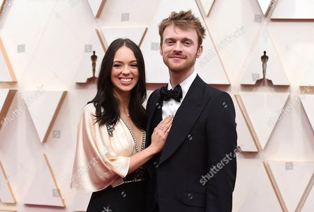 Claudia Sulewski, Finneas O'Connell. Claudia Sulewski, left, and Finneas O'Connell arrive at the Oscars, at the Dolby Theatre in Los Angeles