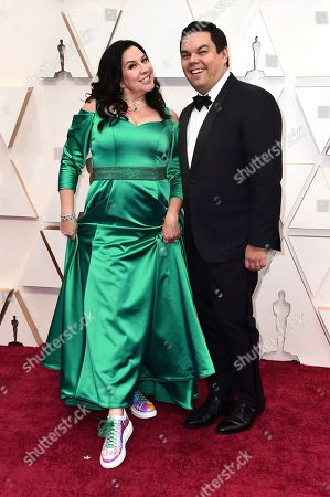 Kristen Anderson-Lopez, Robert Lopez. Kristen Anderson-Lopez, left, and Robert Lopez arrive at the Oscars, at the Dolby Theatre in Los Angeles