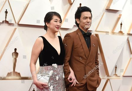 Stock Image of Kerri Higuchi, John Cho. Kerri Higuchi, left, and John Cho arrive at the Oscars, at the Dolby Theatre in Los Angeles