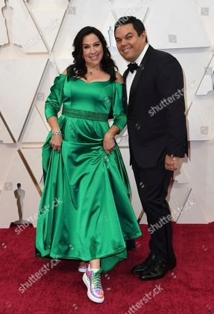 Stock Photo of Kristen Anderson-Lopez, Robert Lopez. Kristen Anderson-Lopez, left, and Robert Lopez arrive at the Oscars, at the Dolby Theatre in Los Angeles