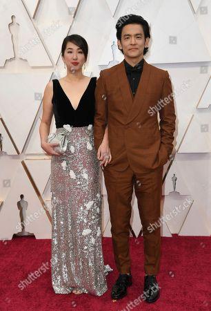 Kerri Higuchi, John Cho. Kerri Higuchi, left, and John Cho arrive at the Oscars, at the Dolby Theatre in Los Angeles