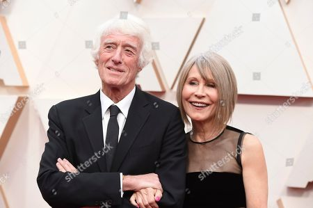 Stock Image of Roger Deakins, Isabella James Purefoy Ellis. Roger Deakins, left, and Isabella James Purefoy Ellis arrive at the Oscars, at the Dolby Theatre in Los Angeles