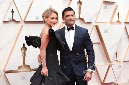 Kelly Ripa, Mark Consuelos. Kelly Ripa, left, and Mark Consuelos arrive at the Oscars, at the Dolby Theatre in Los Angeles