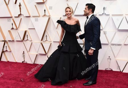 Kelly Ripa, left, and Mark Consuelos arrive at the Oscars, at the Dolby Theatre in Los Angeles