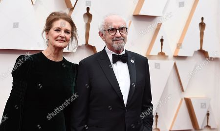 Stock Picture of Kate Fahy, Jonathan Pryce. Kate Fahy, left, and Jonathan Pryce arrive at the Oscars, at the Dolby Theatre in Los Angeles