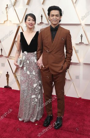 US-Korean actor John Cho (R) and his wife actress Kerri Higuchi arrive for the 92nd annual Academy Awards ceremony at the Dolby Theatre in Hollywood, California, USA, 09 February 2020. The Oscars are presented for outstanding individual or collective efforts in filmmaking in 24 categories.