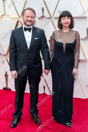 Rian Johnson (L) and his wife Karina Longworth arrive for the 92nd annual Academy Awards ceremony at the Dolby Theatre in Hollywood, California, USA, 09 February 2020. The Oscars are presented for outstanding individual or collective efforts in filmmaking in 24 categories.