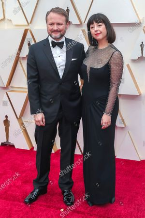 Stock Picture of Rian Johnson (L) and his wife Karina Longworth arrive for the 92nd annual Academy Awards ceremony at the Dolby Theatre in Hollywood, California, USA, 09 February 2020. The Oscars are presented for outstanding individual or collective efforts in filmmaking in 24 categories.