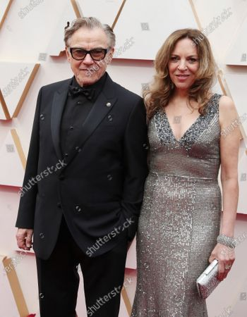 Stock Picture of Harvey Keitel and Daphna Kastner arrive for the 92nd annual Academy Awards ceremony at the Dolby Theatre in Hollywood, California, USA, 09 February 2020. The Oscars are presented for outstanding individual or collective efforts in filmmaking in 24 categories.