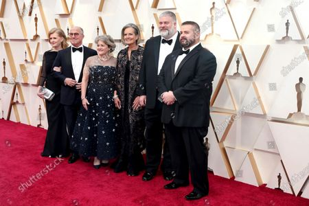 Stock Image of Dean DeBlois (2-R), US producer Bonnie Arnold (3-L) and US producer Bradford Lewis (2-L) and guests arrive for the 92nd annual Academy Awards ceremony at the Dolby Theatre in Hollywood, California, USA, 09 February 2020. The Oscars are presented for outstanding individual or collective efforts in filmmaking in 24 categories.