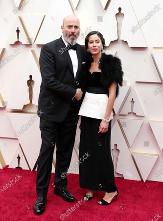 Mark Bridges (L) and guest arrive for the 92nd annual Academy Awards ceremony at the Dolby Theatre in Hollywood, California, USA, 09 February 2020. The Oscars are presented for outstanding individual or collective efforts in filmmaking in 24 categories.