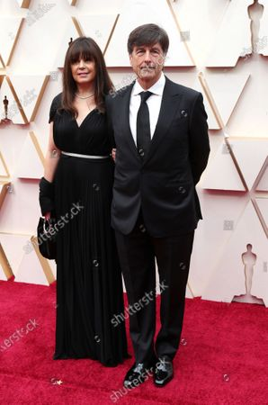 Stock Image of Thomas Newman and his wife Ann Marie Zirbes arrive for the 92nd annual Academy Awards ceremony at the Dolby Theatre in Hollywood, California, USA, 09 February 2020. The Oscars are presented for outstanding individual or collective efforts in filmmaking in 24 categories.