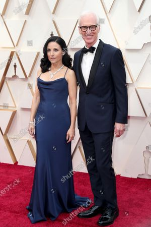 Julia Louis-Dreyfus (L) and husband Brad Hall arrive for the 92nd annual Academy Awards ceremony at the Dolby Theatre in Hollywood, California, USA, 09 February 2020. The Oscars are presented for outstanding individual or collective efforts in filmmaking in 24 categories.