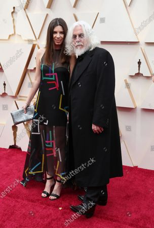 Robert Richardson and a guest arrive for the 92nd annual Academy Awards ceremony at the Dolby Theatre in Hollywood, California, USA, 09 February 2020. The Oscars are presented for outstanding individual or collective efforts in filmmaking in 24 categories.