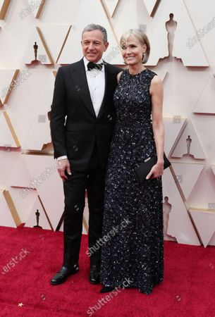 Willow Bay (R) and Bob Iger (L) arrive for the 92nd annual Academy Awards ceremony at the Dolby Theatre in Hollywood, California, USA, 09 February 2020. The Oscars are presented for outstanding individual or collective efforts in filmmaking in 24 categories.