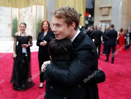 Alfie Allen, Archie Yates. Alfie Allen, right, embraces Archie Yates on the red carpet at the Oscars, at the Dolby Theatre in Los Angeles