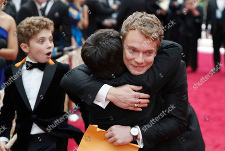 Roman Griffin Davis, Archie Yates, Alfie Allen. Roman Griffin Davis, from left, walks on the red carpet as Archie Yates and Alfie Allen embrace at the Oscars, at the Dolby Theatre in Los Angeles