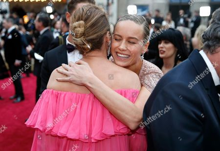 Brie Larson, right, and Sunrise Coigney embrace upon arrival at the Oscars, at the Dolby Theatre in Los Angeles