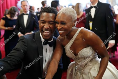 Scott Evans, Cynthia Erivo. Scott Evans, left, and Cynthia Erivo arrive at the Oscars, at the Dolby Theatre in Los Angeles