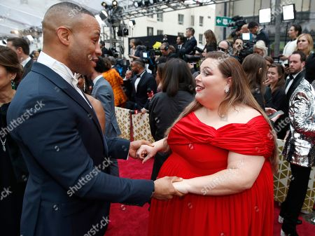 Stock Picture of DeVon Franklin, Chrissy Metz. DeVon Franklin, left, and Chrissy Metz arrive at the Oscars, at the Dolby Theatre in Los Angeles
