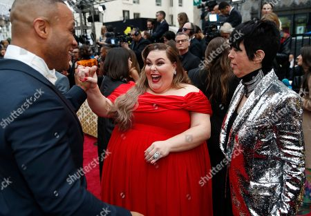 Stock Image of DeVon Franklin, Chrissy Metz, Diane Warren. DeVon Franklin, from left, Chrissy Metz and Diane Warren arrive at the Oscars, at the Dolby Theatre in Los Angeles