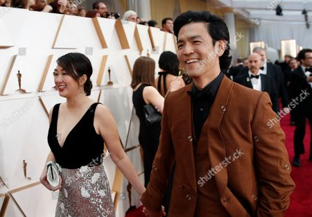 Stock Photo of Kerri Higuchi, John Cho. Kerri Higuchi, left, and John Cho arrive at the Oscars, at the Dolby Theatre in Los Angeles
