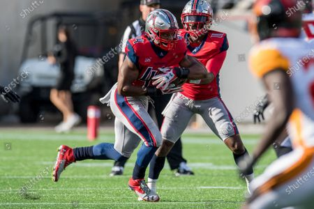 Houston Roughnecks running back Andre Williams (44) takes a handoff form quarterback P.J. Walker (11) during the 1st quarter of an XFL football game between the LA Wildcats and the Houston Roughnecks at TDECU Stadium in Houston, TX. The Roughnecks won the game 37 to 17