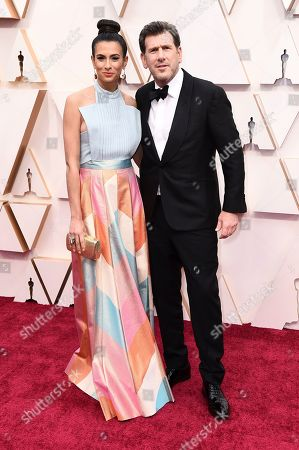 Stock Picture of Jessica Sher, Lawrence Sher. Jessica Sher, left, and Lawrence Sher arrive at the Oscars, at the Dolby Theatre in Los Angeles
