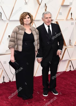 Stock Image of Amy Pascal, Bernard Weinraub. Amy Pascal, left, and Bernard Weinraub arrive at the Oscars, at the Dolby Theatre in Los Angeles