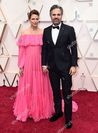 Stock Image of Sunrise Coigney, Mark Ruffalo. Sunrise Coigney, left, and Mark Ruffalo arrive at the Oscars, at the Dolby Theatre in Los Angeles