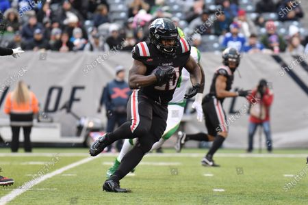 Tim Cook III (20) of the New York Guardians carries the ball during a game against the Tampa Bay Vipers at MetLife Stadium on , in East Rutherford, New Jersey