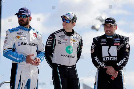 Martin Truex Jr., left, Brad Keselowski, center and Ryan Newman get together during introductions for the NASCAR Busch Clash auto race at Daytona International Speedway, in Daytona Beach, Fla