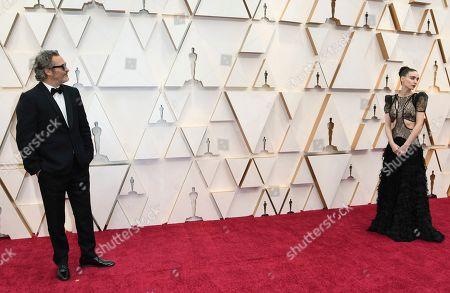Joaquin Phoenix, Rooney Mara. Joaquin Phoenix, left, and Rooney Mara arrive at the Oscars, at the Dolby Theatre in Los Angeles