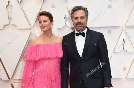 Stock Photo of Sunrise Coigney, Mark Ruffalo. Sunrise Coigney, left, and Mark Ruffalo arrive at the Oscars, at the Dolby Theatre in Los Angeles