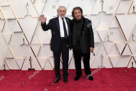 Robert De Niro, Al Pacino. Robert De Niro, left, and Al Pacino arrive at the Oscars, at the Dolby Theatre in Los Angeles