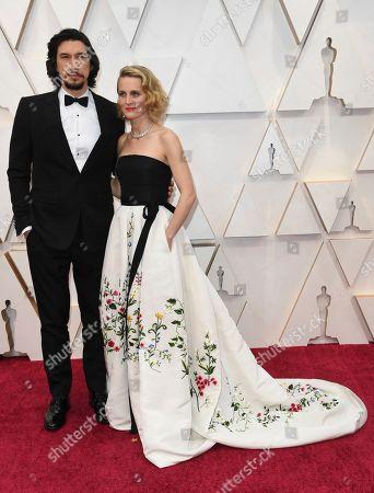 Adam Driver, left, Joanne Tucker. Adam Driver, left, and Joanne Tucker arrive at the Oscars, at the Dolby Theatre in Los Angeles