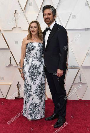 Stock Image of Anna Romano, Ray Romano. Anna Romano, left, and Ray Romano arrive at the Oscars, at the Dolby Theatre in Los Angeles