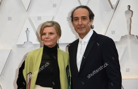 Stock Image of Dominique Lemonnier, Alexandre Desplat. Dominique Lemonnier, left, and Alexandre Desplat arrive at the Oscars, at the Dolby Theatre in Los Angeles