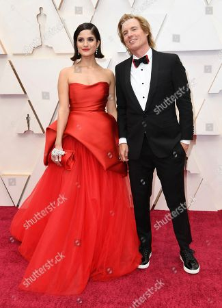 Stock Image of Kiana Madani, Bryan Buckley. Kiana Madani, left, and Bryan Buckley arrive at the Oscars, at the Dolby Theatre in Los Angeles