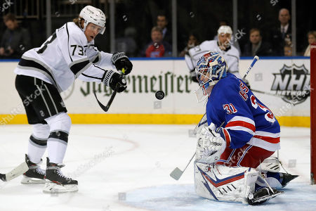 New York Rangers goaltender Igor Shesterkin (31) makes a save on a shot by Los Angeles Kings right wing Tyler Toffoli (73) in the first period of an NHL hockey game, in New York