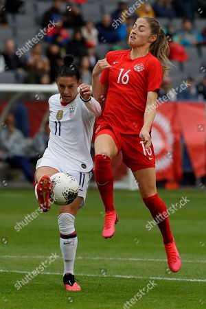 U.S. defender Ali Krieger, left, blocks a shot by Canada forward Janine Beckie during the first half of a CONCACAF women's Olympic qualifying soccer match, in Carson, Calif