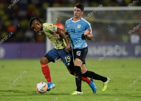 Luis Sandoval (L) of Colombia vies for the ball with Joaquin Piquerez of Uruguay during their South American Soccer U-23 Tournament match between Colombia and Uruguay, at Alfonso Lopez stadium in Bucaramanga, Colombia, 09 February 2020.