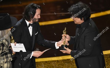 "Diane Keaton, Keanu Reeves, Bong Joon Ho. Diane Keaton, from left, and Keanu Reeves present the award for best original screenplay to Bong Joon Ho for ""Parasite"" at the Oscars, at the Dolby Theatre in Los Angeles"