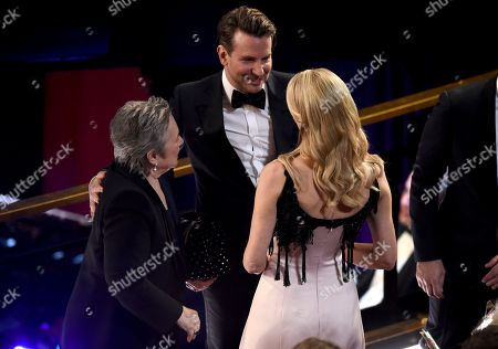 Kathy Bates, Bradley Cooper, Laura Dern. Kathy Bates, from left, Bradley Cooper and Laura Dern appear in the audience at the Oscars, at the Dolby Theatre in Los Angeles