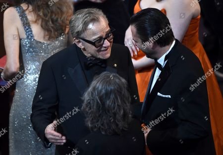 Harvey Keitel, left, is seen in the audience before the start of the Oscars, at the Dolby Theatre in Los Angeles