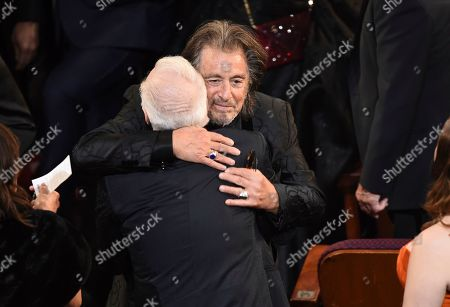 Al Pacino, Martin Scorsese. Al Pacino, right, embraces Martin Scorsese in the audience at the Oscars, at the Dolby Theatre in Los Angeles