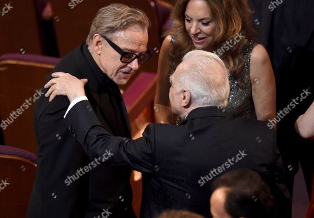 Harvey Keitel, Martin Scorsese. Harvey Keitel, left, greets Martin Scorsese in the audience at the Oscars, at the Dolby Theatre in Los Angeles