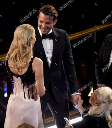 Laura Dern, Bradley Cooper, Diane Ladd. Laura Dern, from left, greets Bradley Cooper in the audience, as Diane Ladd looks, at the Oscars, at the Dolby Theatre in Los Angeles